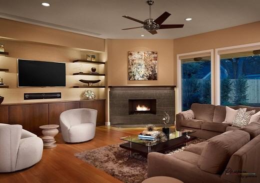 На данном фото представлен современный угловой камин в интерьере гостиной