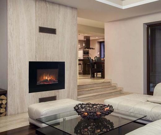 На фото стильный настенный электрокамин «Real Flame» (модель «Андромеда») в интерьере