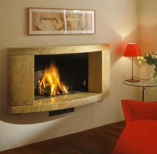 На фото электрокамин, способный издавать звуки потрескивающих дров в огне