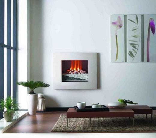 На фото представлен встраиваемый в стену электрокамин, применяемый как дополнительный декоративный элемент интерьера, выполненного в стиле минимализма